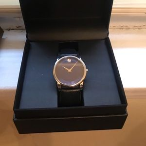 Blue face Movado with a black leather strap